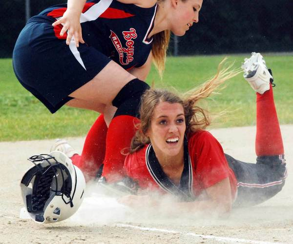 Boyne City third basemen Ketrin Hocquard (left) tags out East Jordans Emily Crick Tuesday during a Division III pre-district softball game at East Jordan High School. The Ramblers won, 3-0, to advance to a district semifinal on Saturday, June 2.