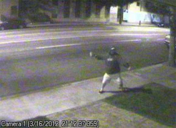 A vandal is seen in the video footage throwing a brick at Councilman David Gordon's business.