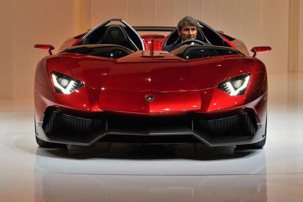 Lamborghini President and CEO Stephan Winkelmann in the new Lamborghini Aventador model car during a preview ahead of the 82nd Geneva Car Show in Switzerland.