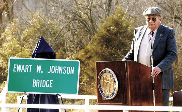 Former Kentucky State Parks Commissioner Ewart Johnson of Winchester speaks during the re-naming of the Boonesboro Bridge to the Ewart W. Johnson Bridge in December 2002. Johnson oversaw the construction of Fort Boonesborough during his tenure as parks commissioner. Johnson died May 24 in Clearwater, Fla.