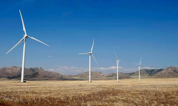 Wind turbines operate at a wind farm near Milford, Utah. The Milford Wind Corridor Project, developed by the First Wind energy company, is a 306-megawatt, 165-unit wind farm.