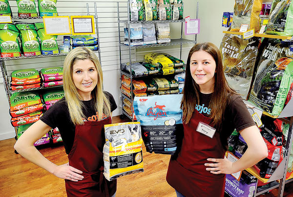 Tracy Blair, left, owner of Hearty Pet, and Manager Tory Burch stand amid products sold at the store at 727 Premium Outlets Blvd. in Hagerstown.