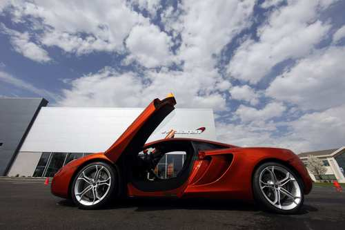 The McLaren MP4-12C is an all-new, mid-engined, rear-wheel-drive car. Above, a 12C at a dealership in West Chester, Pa.