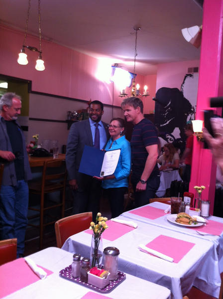 "Chef Ramsay, Baltimore City Councilman Nick Mosby pose with Cafe Hon owner Denise Whiting during the taping of ""Kitchen Nightmares."" Mosby presented Whiting with a resolution from the city."