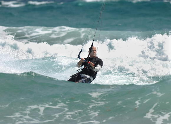 A man goes kiteboarding off Delray Beach. Expect another day with a mix of sun and clouds on Thursday.