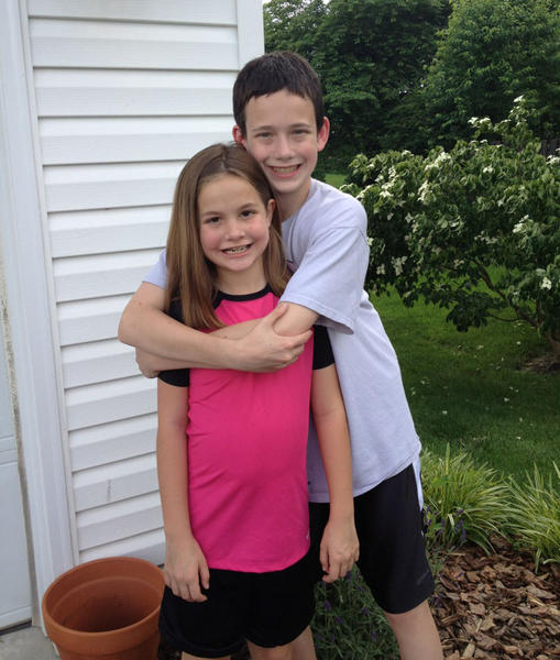 Mackenzie McCarter, 8, with her brother Jake, 12, wrapping his arms around her.