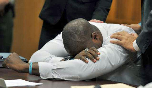 Brian Banks weeps after his rape conviction was dismissed.