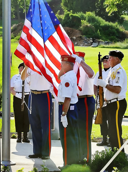 AMVETS Post 10 and Marine Corps League raise the flag at a Memorial Day ceremony in Smithsburg on Wednesday.