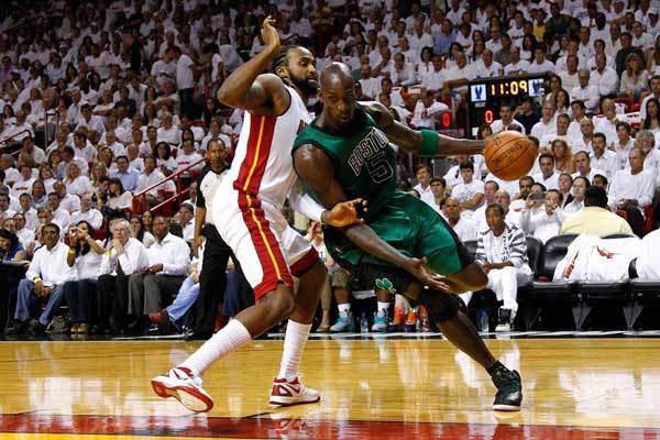 Kevin Garnett #5 of the Boston Celtics drives in the first quarter against Ronny Turiaf #21 of the Miami Heat in Game Two of the Eastern Conference Finals in the 2012 NBA Playoffs on May 30, 2012 at American Airlines Arena in Miami, Florida.