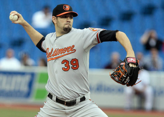 Jason Hammel of the Orioles throws a pitch against the Toronto Blue Jays.