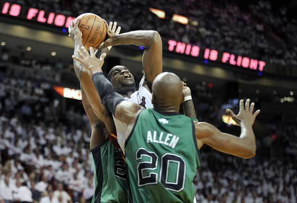 Miami Heat center Joel Anthony tries to get a shot off against the Boston Celtics defense during the second quarter of Game 2 of their Round 3 playoff game, Wednesday, May 30, 2012, at AmericanAirlines Arena.