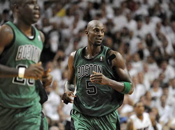 Miami Heat guard Dwyane Wade dribbles to avoid the double team of Boston Celtics Kevin Garnett and Mickael Pietrus during the second quarter of Game 2 of their Round 3 playoff game, Wednesday, May 30, 2012, at AmericanAirlines Arena.