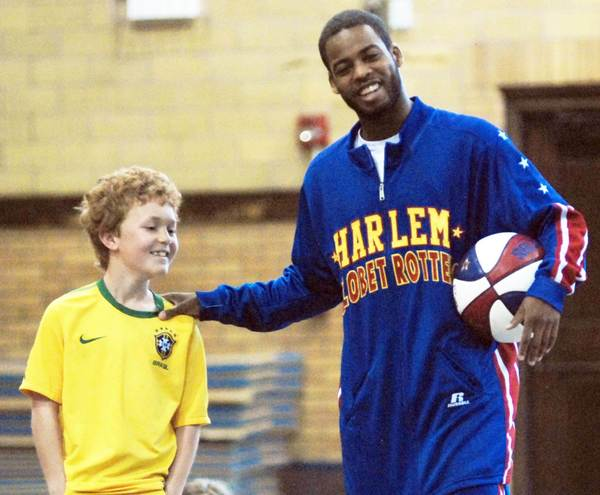 Anthony Ant Atkinson (right) of the Harlem Globetrotters shares a laugh with Michael Iverson, a 9-year old third grader at the Petoskey Central Elementary School gym Wednesday during Atkinsons visit to the area.