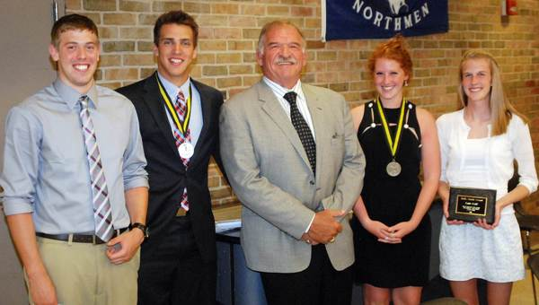 Pro Football Hall of Famer Dan Dierdorf (center) poses Wednesday at the 67th annual Petoskey High School Varsity Awards Banquet at Petoskey High School. Award winners included (from left) Zak Lewis, Detroit Free Press Scholar-Athlete; Joe Robbins, U.S. Army Reserve Scholar Athlete Award; Olivia Pizii, U.S. Army Reserve Scholar Athlete Award; and Katie Kidd, Kelly Smith Award.