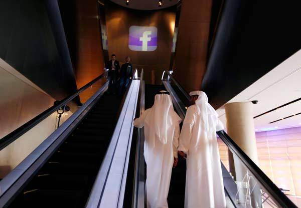 The Facebook logo is seen in front of an escalator at the venue of a news conference announcing the opening of Facebook offices in Dubai.