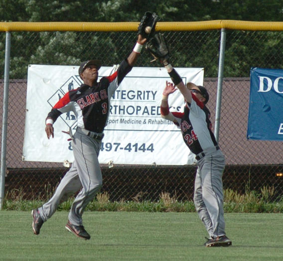 Clark outfielder Pokey Harris, left, makes a catch in front of right fielder Scotty Turner in the seventh inning.