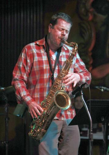 Ken Vandermark with saxophone at the Green Mill.