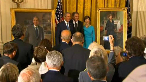 George W. Bush and Laura Bush pose with artist John Howard Sanden at a White House ceremony on Thursday.
