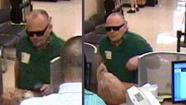A man charged in the robbery of a West Side branch bank had withdrawn money from his own account, then turned his shirt inside out and put on sunglasses as a disguise before using a water pistol to rob the place, authorities said.