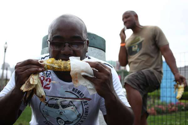 Maurice Johnson, of San Jose, Calif., left, and Ralph Jones, of Detroit, Mich., enjoy corn on the cob at the Taste of Chicago on Saturday July 2, 2011.