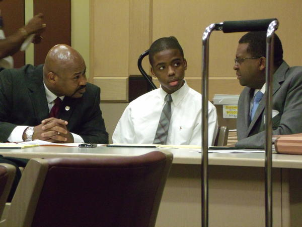 Matthew Bent (center) glances at his family as his lawyers advise him during the first phase of jury selection in his attempted murder trial Thursday. Bent is accused of leading the Oct. 2009 attack on Michael Brewer in Deerfield Beach. His attorneys are Johnny McCray (left) and Perry Thurston (right).