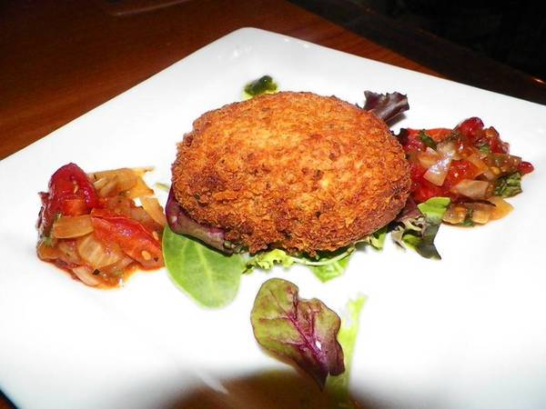 The fried fresh mozzarella with roasted tomato relish and basil oil at Mezzo Grille.