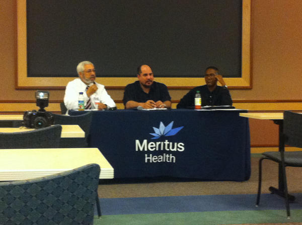Dr. Abdul Waheed, left, Jon Freeman, center, and Andy Smith, right, lead a panel discussion Thursday about the dangerous effects of tobacco on a person's health.