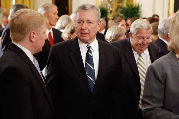 John Ashcroft, center, was the first attorney general under Bush.
