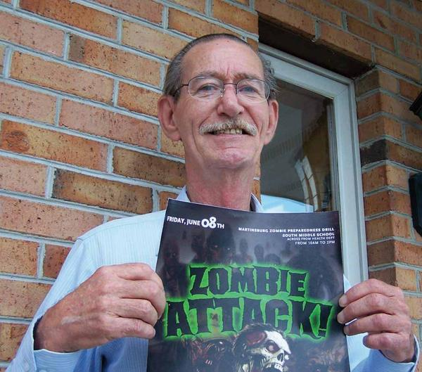 Carl French, the Berkeley County Health Department's threat preparedness coordinator holds a flier promoting the first ever zombie-themed emergency preparedness drill for first responders. The June 8 event is open to the public and residents are encouraged to dress up as zombies.