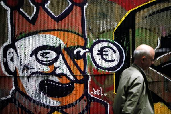 In Athens, graffiti depicting Greece as a clown getting a black eye from the euro provides commentary on the nation's fiscal crisis.