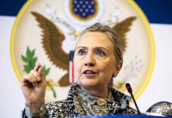 """U.S. Secretary of State Hillary Rodham Clinton speaks in Copenhagen, where she said that Russia's actions in Syria are not a """"stabilizing influence."""""""