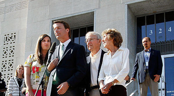 Former Sen. John Edwards addresses the news media alongside his daughter Cate Edwards and his parents, Wallace and Bobbie Edwards, outside federal court in Greensboro, N.C., where a mistrial was declared in the campaign finance case against him. Experts say they doubt federal prosecutors will attempt to retry the case.