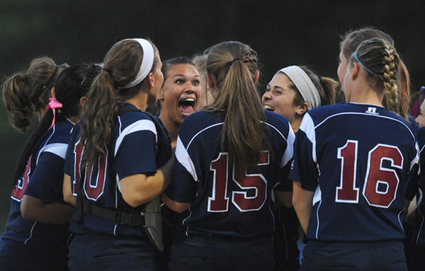 Liberty High School girls softball team begins to celebrate their District 11 4A softball championship victory over Emmaus High School at Patriots Park in Allentown Thursday night.