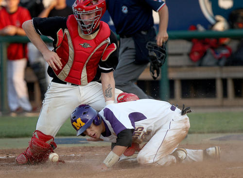 Tanner Woods of Menchville gets in safe at home as Zach Vann of Nansemond River loses the ball during the sixth inning Thursday in Norfolk.