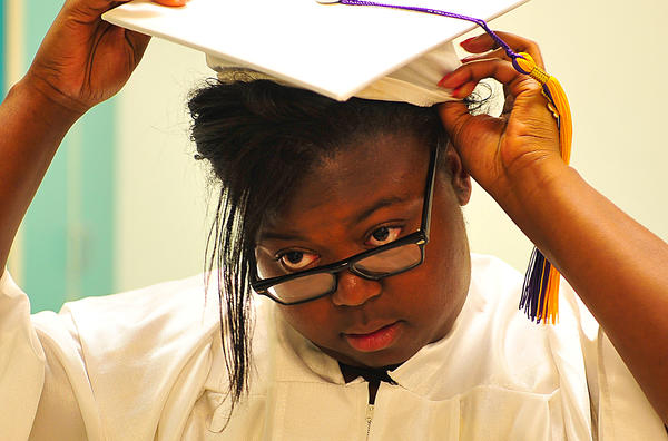 Washington County Evening High School student Gaelle B. Hadjia-Kamga adjusts her cap Thursday night before commencement ceremony at Washington County Technical High School. Hadjia-Kamga gave one of the graduation addresses.