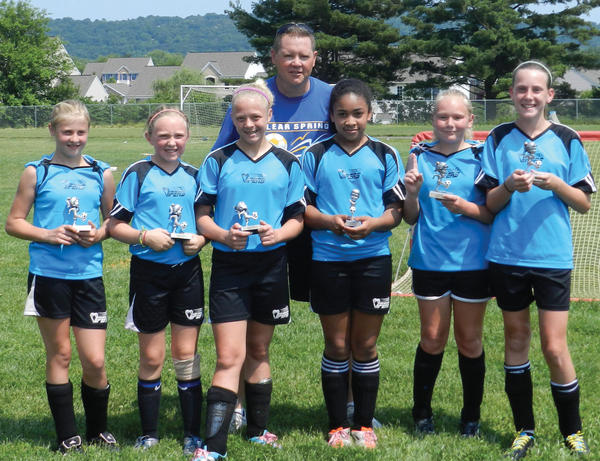 The Clear Spring Vipers girls U-12 soccer team won the Middletown 4-v-4 Memorial Day Tournament, going 5-0-1. From left to right: Celia Ramacciotti, Maggie Elwood, Meghan Byers, coach Eric Ramacciotti, Jaiden McKinney, Hope Forsythe and Leah Howard. Not pictured: Coach John Ardinger.