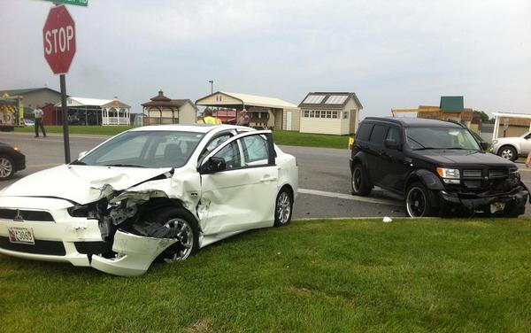 A Mitsubishi Lancer and a Dodge Nitro were damaged in a crash Friday morning at the intersection of Sharpsburg Pike (Md. 65) and Poffenberger Road. The driver of the Lancer was taken to Meritus Medical Center.
