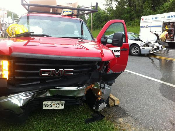A GMC pickup truck, in foreground, and a Mitsubishi Eclipse, at right, collided Friday morning on Sharpsburg Pike (Md. 65) south of Lappans Road. Four people were transported from the scene.