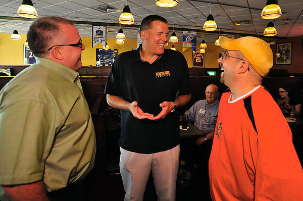 Uniiversity of Maryland head football coach Randy Edsall, center, talks with fans Rich Hyland, left, and Joe Ardizzone on Thursday. Edsall, along with other coaches and players from Maryland, made a Hagerstown appearance  at The Greene Turtle.