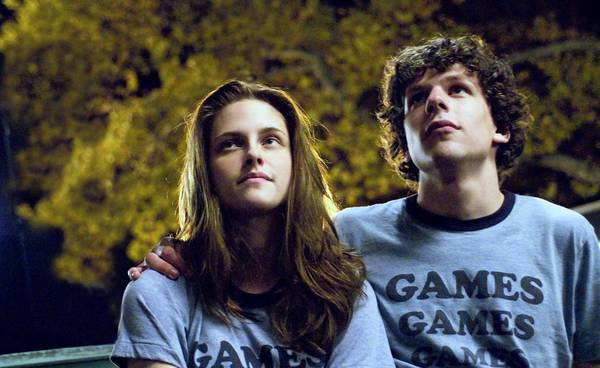 "Kristen Stewart and Jesse Eisenberg in the 2009 film ""Adventureland."""