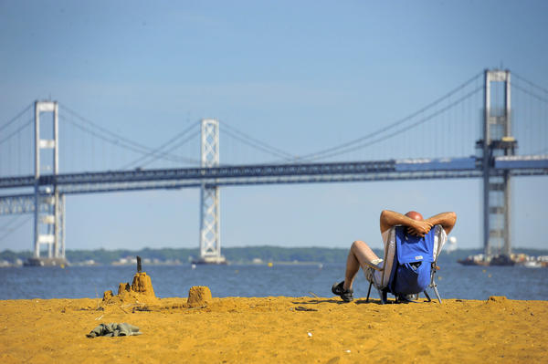 Relaxing as he looks onto the Bay Bridge, Lou Papas of Silver Spring enjoys the afternoon near Annapolis Thursday.