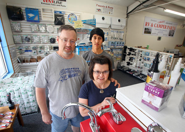 Mark and Lise Bower with their son Ryan, back center, of Aberdeen Parts Store at 21 Second Ave. N.W. photo by john davis taken 5/22/2012