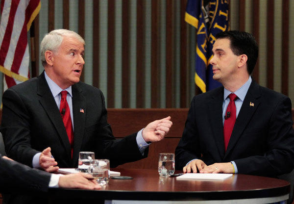 Democratic challenger and Milwaukee Mayor Tom Barrett (L) and Republican Wisconsin Governor Scott Walker, who is facing a recall election, talk during a debate held at Marquette University Law School in Milwaukee, Wisconsin May 31, 2012.