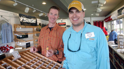 Ethan Winchester (right) is the store manager and head guide at the new Boyne Outfitters business at Boyne Mountain Resort in Boyne Falls, while Brian Kozminski is one of three other guides at the fishing shop.