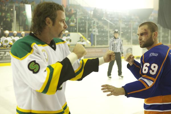 "In the brash comedy ""Goon,"" Seann William Scott, right, plays a lovable lunkhead who makes an unlikely rise through the ranks of hockey thanks to his fists. He eventually finds himself facing off against a crafty veteran played by Liev Schreiber."