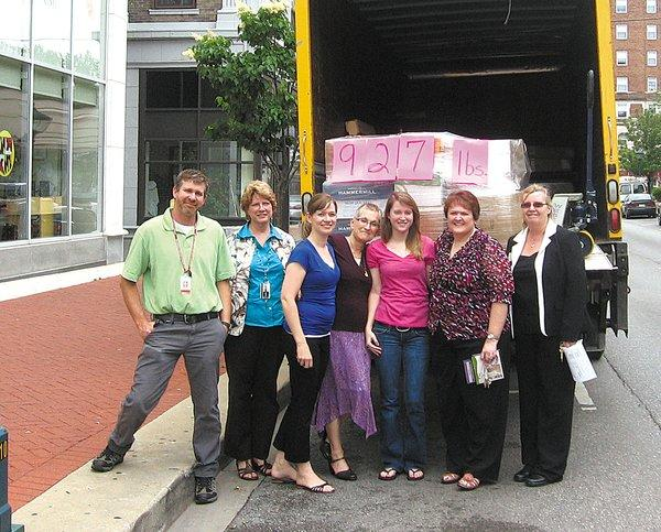 Helping with packing donated books into a truck bound for Georgia are, from left, Mark Rini-Stevens, University System of Maryland-Hagerstown maintenance mechanic; Toni Tracey, Towson University nursing department administrative assistant; Mindy Haluska, TU faculty; Tyree Morrison, TU faculty; Hannah Bradley, TU nursing student and USMH student council vice-president; Kathy Rabon, TU faculty; and Judy Breitenbach, TU faculty.