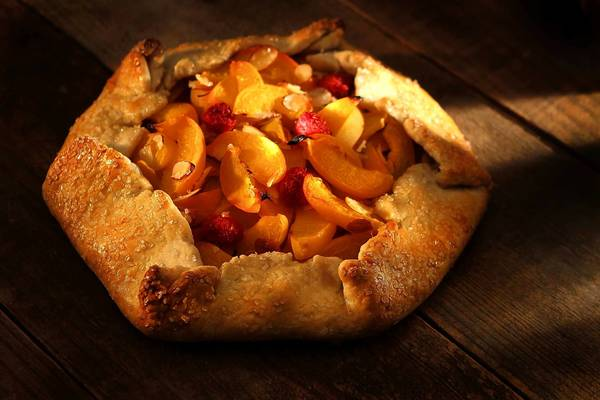 You can combine apricots, raspberries and shaved almonds in an easy summer fruit galette.