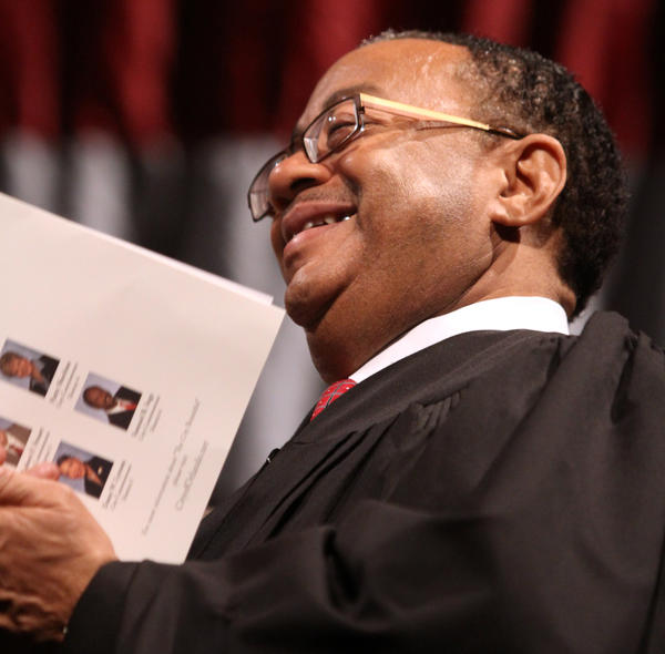 Ninth circuit chief Judge Belvin Perry gets a laugh from remarks by Orlando commissioner Sam Ings after Ings took the Oath of Office, during the swearing-in ceremony, Friday, June 1, 2012, at Bob Carr Auditorium in Orlando. Orlando mayor Buddy Dyer and four city commissioners were sworn-in.