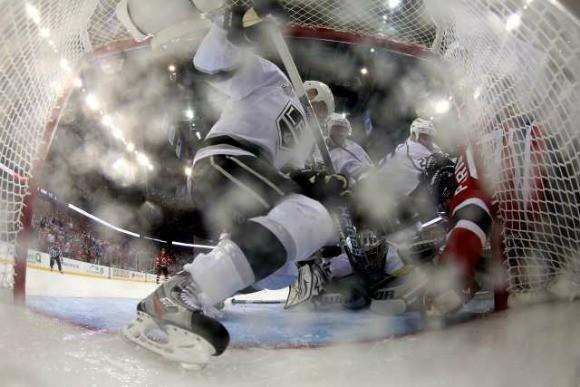 Zach Parise of the New Jersey Devils directs the puck into the net with his hand, resulting in a disallowed goal, during Game 1 of the Stanley Cup Final against the Los Angeles Kings.