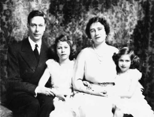 Princess Elizabeth and her younger sister, Princess Margaret, are shown in 1937 with their parents, King George VI and Queen Elizabeth.
